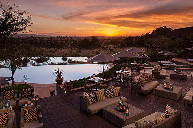 Four Seasons Safari Lodge - Maji Bar & Swimming Pool at Sunset