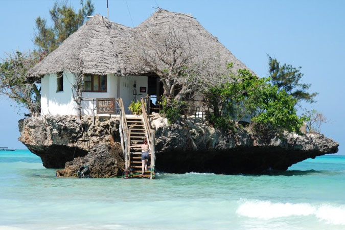 Don't miss Zanzibar's most idyllically-set seafood restaurant, The Rock, perched on a coral outcrop and only accessible at low tide.